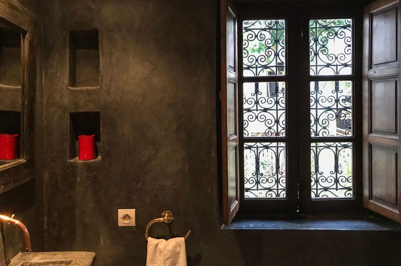 marrakech riad bathroom with dark grey polished plaster finish