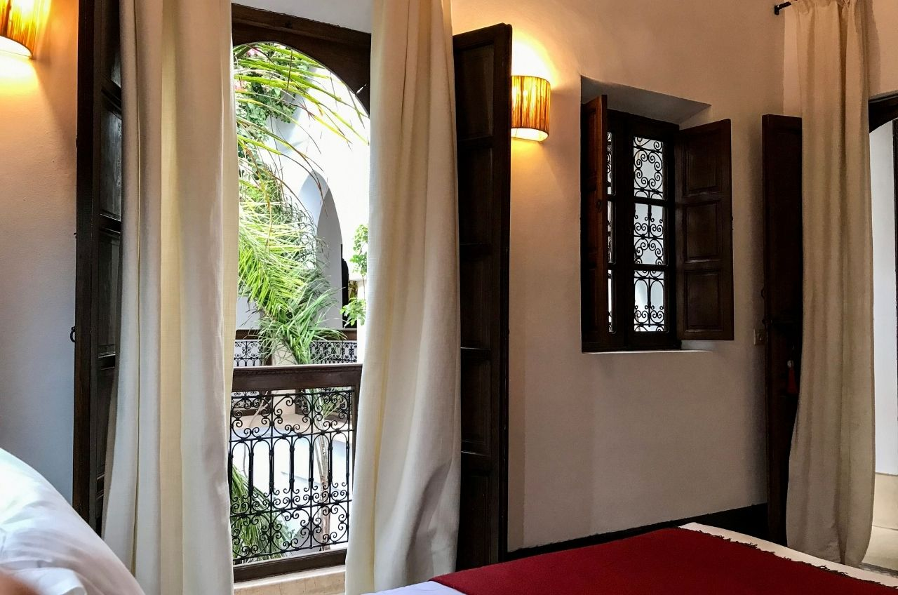 bedside view of balcony over courtyard