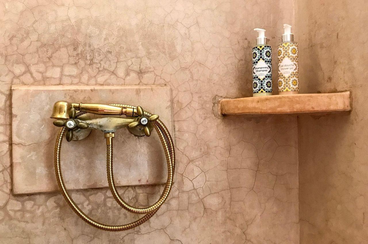 marrakesh riad tadelakt shower with shelf and shower gel